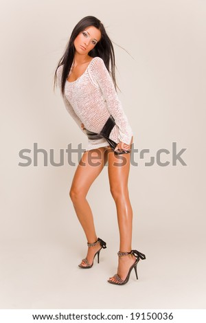 Beautiful girl in fashion dress with belt, studio isolated