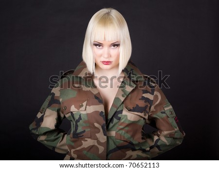 Beautiful girl in military clothes. studio shot