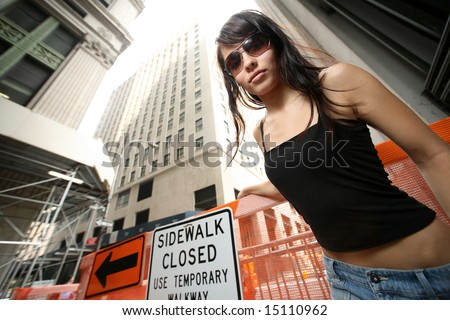 Beautiful girl in New York City. Wide angle view from below. - stock photo