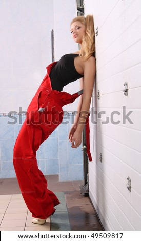 stock-photo-beautiful-girl-in-overalls-at-the-gate-of-the-garage-49509817.jpg