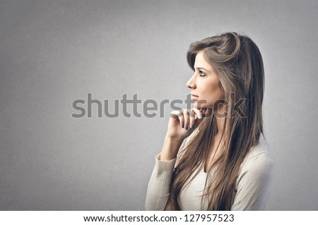 beautiful girl in profile on a gray background