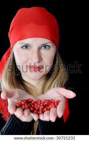 Beautiful girl in red kerchief with bead in hands, on black background