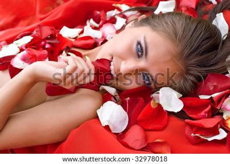 Beautiful girl in rose petal. Spa resort