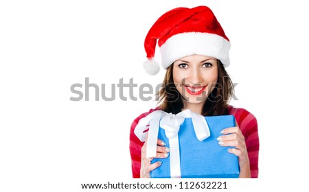 Beautiful girl in Santa hat with blue looking at the camera