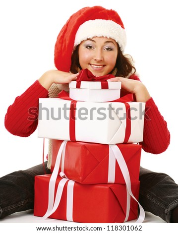Beautiful girl in santa hat with gift christmas decorated background