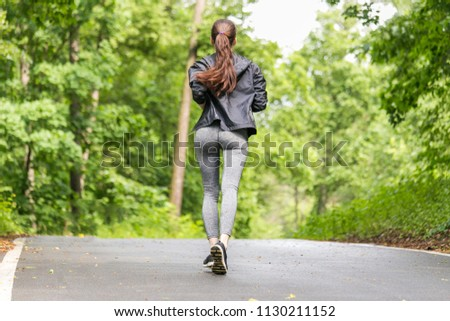 beautiful girl in sports uniform, doing exercises on the street, running around, drinking water. Healthy way of life, an infused figure #1130211152
