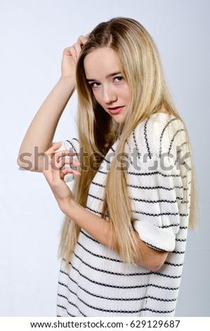 beautiful girl in striped sweater #629129687