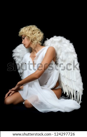Beautiful girl in suit of white angel