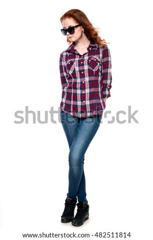 Beautiful girl in sunglasses in a full-length isolated on white background. Young pretty curly woman in plaid shirt and jeans posing #482511814