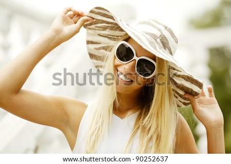 beautiful girl in sunglasses smiles - stock photo