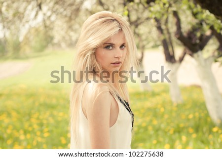 beautiful girl in the garden on a sunny day