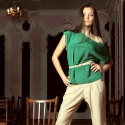 Beautiful girl in the little green tunic