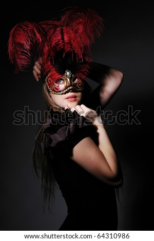 beautiful girl in the mask on a black background