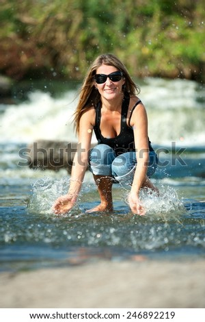Beautiful girl in the open air, on the bank of a mountain river #246892219