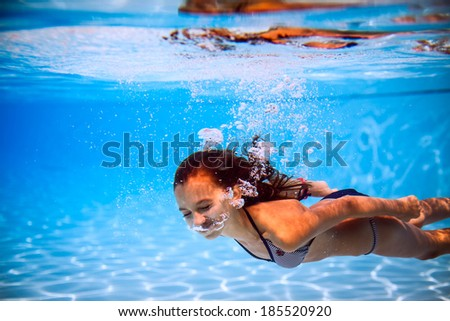 beautiful girl in the pool #185520920
