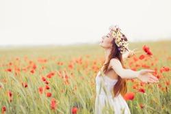 beautiful girl in the poppy field