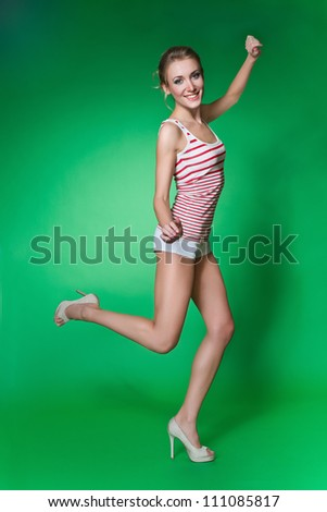 Beautiful girl  in the shorts is smiling