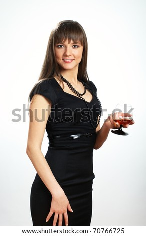 Beautiful girl in tight black dress with cognac glass