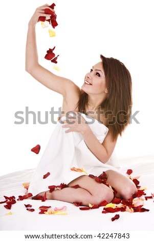 Beautiful girl in towel with  rose petal. Isolated