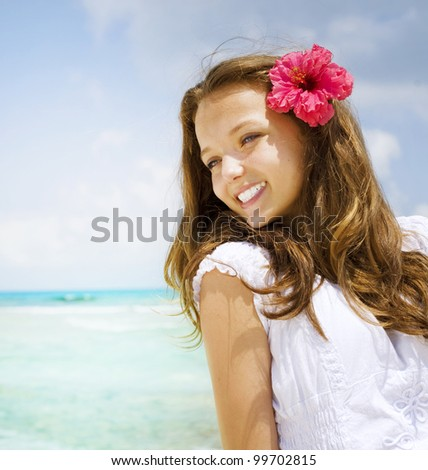 Beautiful Girl in Tropical Resort. Travel and Vacation concept.Ocean Beach
