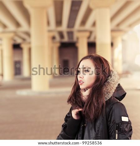 beautiful girl in waiting under the bridge