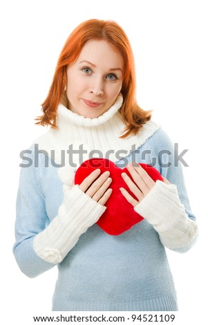 Beautiful girl in warm clothes with a heart on a white background.