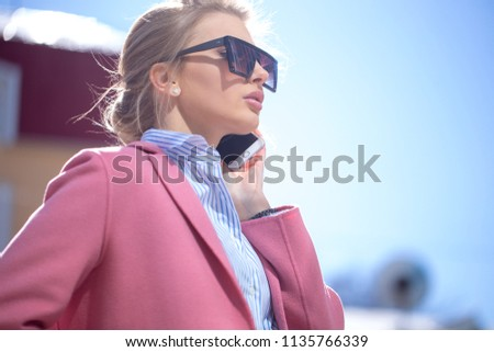 beautiful girl in warm spring clothes. close up photo #1135766339