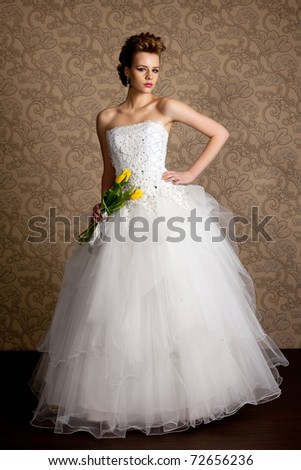 beautiful girl  in wedding dress with tulips