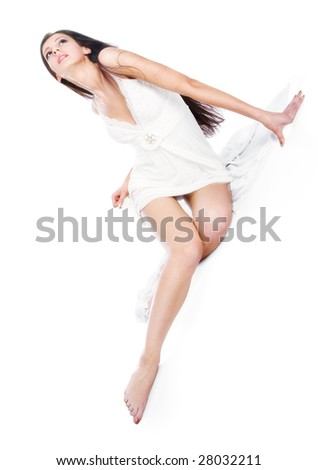 beautiful girl in white dress on the isolated background - stock photo