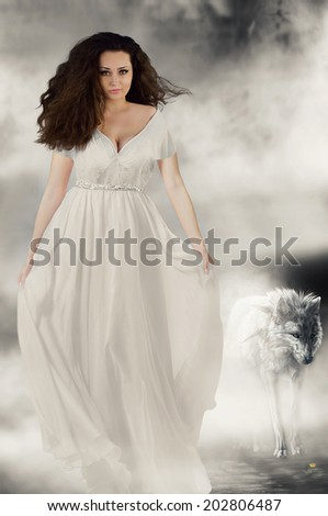 Beautiful girl in white dress with white wolf Book cover