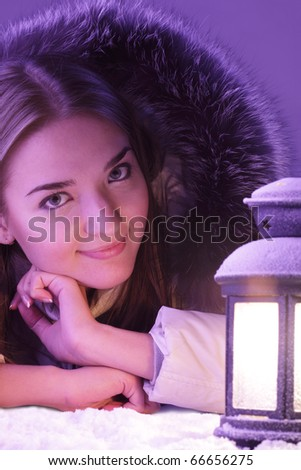 beautiful girl in winter with lantern - stock photo