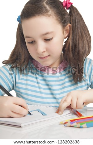 Beautiful girl is drawing with color pencils isolated in white
