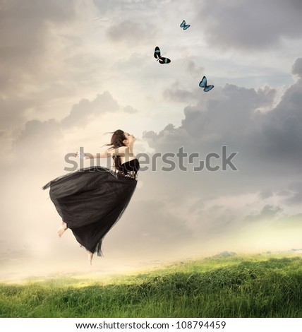 Stock Photo Beautiful Girl Jumping in the Air on a Mountain