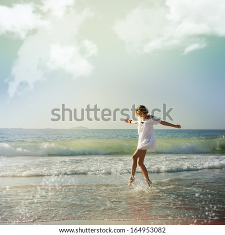 Beautiful Girl Jumping on The Beach
