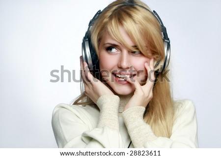 Beautiful girl listening music in headphones.