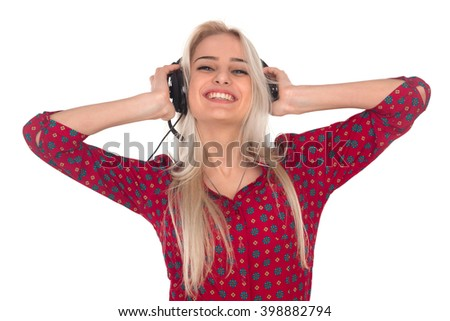 Beautiful girl listens to music on headphones #398882794