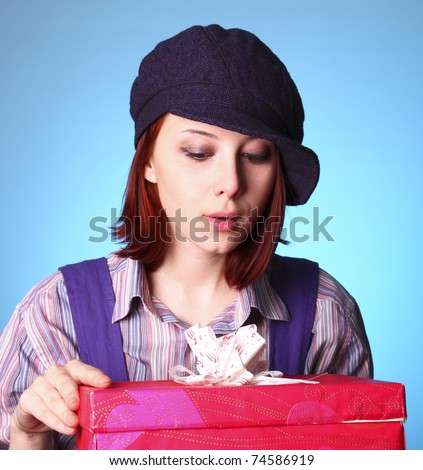 Beautiful girl looking at present in St. Valentine\'s Day