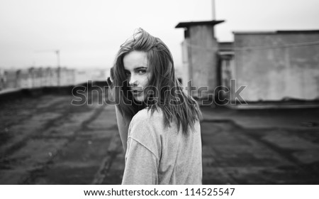 beautiful girl looking back on the roof