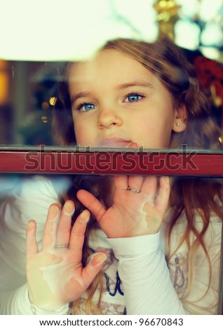 beautiful girl looking out the window. outside view