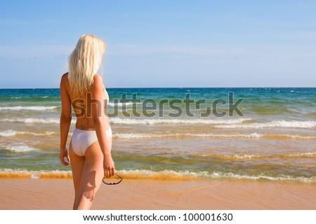 Beautiful girl looking to the sea. #100001630