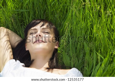 beautiful girl lying down of...