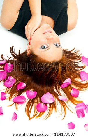 beautiful girl lying on a background of rose petals #114199387