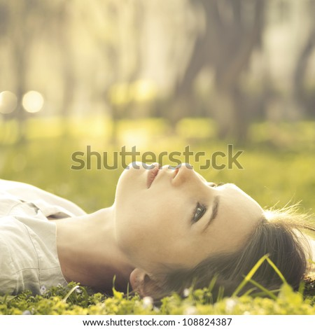 beautiful girl lying on a meadow