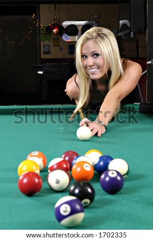 Beautiful girl making a pool shot