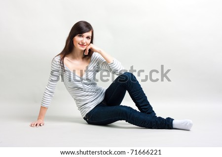 Beautiful girl on a gray background