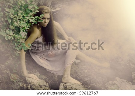 beautiful girl on stones near a mountain river. Morning's fog