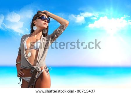 Beautiful girl on the beach enjoying the Ionian sea in Greece