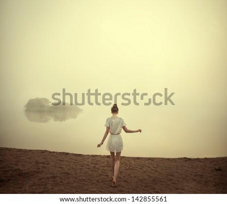 beautiful girl on the beach in...