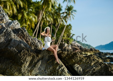 Beautiful girl on the beach with coconut in Thailand #1344126959