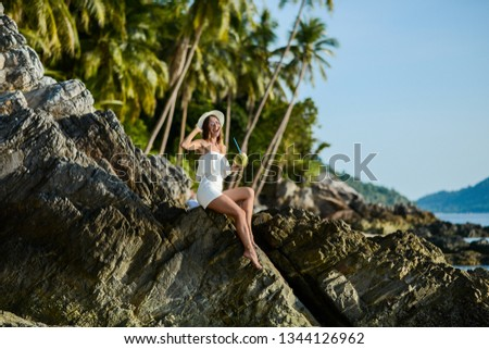Beautiful girl on the beach with coconut in Thailand #1344126962